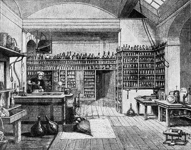 Faraday ve své laboratoři, kde konstruoval klec